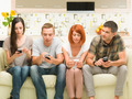 friends playing on smartphones - PhotoDune Item for Sale