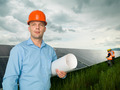 engineer standing in front of solar panels - PhotoDune Item for Sale