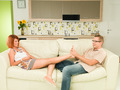 couple relaxing at home on sofa - PhotoDune Item for Sale
