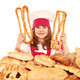 little girl cook with pastry pretzels and breads - PhotoDune Item for Sale
