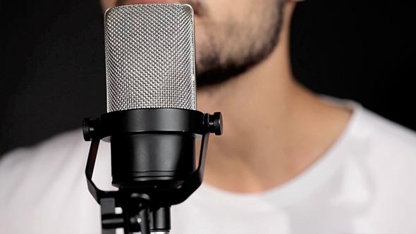 Men Singing At Microphone