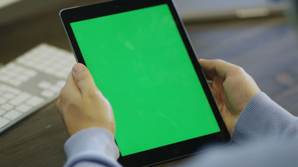 Designer Using Digital Tablet with Green Screen
