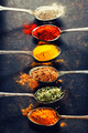Colorful spices in metal spoons - PhotoDune Item for Sale