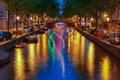 Night city view of Amsterdam canal and luminous track from the b - PhotoDune Item for Sale