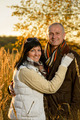Romantic couple hugging autumn sunset countryside - PhotoDune Item for Sale