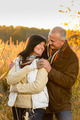 Couple in love hugging in autumn countryside - PhotoDune Item for Sale