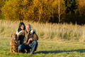 Cheerful couple with dog in autumn countryside - PhotoDune Item for Sale