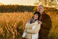 Romantic couple hugging in countryside autumn sunset - PhotoDune Item for Sale