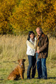 Couple with dog in park autumn sunset - PhotoDune Item for Sale