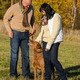 Couple training dog in sunny autumn park - PhotoDune Item for Sale