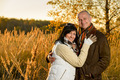 Couple embracing in autumn countryside sunset - PhotoDune Item for Sale