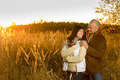 Couple hugging during autumn sunset countryside - PhotoDune Item for Sale