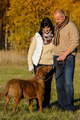Couple with dog in sunny autumn park - PhotoDune Item for Sale