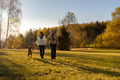 Couple walking dog autumn sunset landscape - PhotoDune Item for Sale