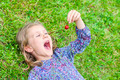 girl lying on the grass with cherry - PhotoDune Item for Sale