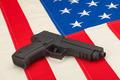 Handgun over USA flag - PhotoDune Item for Sale