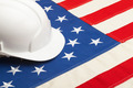 White color construction helmet laying over USA flag - closeup shoot - PhotoDune Item for Sale