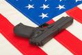 Handgun laying over USA flag - studio shoot - PhotoDune Item for Sale