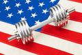 Metal dumbbells over USA flag as symbol of healthy nation - studio shot - PhotoDune Item for Sale