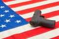 Handgun over USA flag - studio shoot - PhotoDune Item for Sale