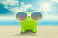 Piggy bank in sunglasses on the beach - vacation concept - PhotoDune Item for Sale