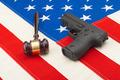 Wooden judge gavel and gun over USA flag - studio shot - PhotoDune Item for Sale