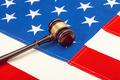 Wooden judge gavel over US flag - PhotoDune Item for Sale