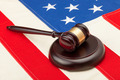 Wooden judge gavel and soundboard laying over USA flag - closeup shot - PhotoDune Item for Sale