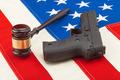 Wooden judge gavel and gun over US flag - studio shot - PhotoDune Item for Sale