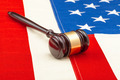 Wooden judge gavel over US flag - closeup studio shot - PhotoDune Item for Sale
