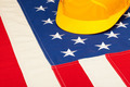 Construction helmet laying over US flag - closeup shoot - PhotoDune Item for Sale