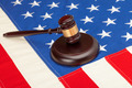 Wooden judge gavel and soundboard laying over US flag - closeup shot - PhotoDune Item for Sale