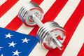 Metal dumbbells over US flag as symbol of healthy nation - studio shot - PhotoDune Item for Sale