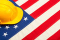 Construction helmet laying over US flag - PhotoDune Item for Sale