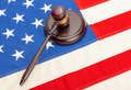 Wooden judge gavel and soundboard laying over US flag - PhotoDune Item for Sale