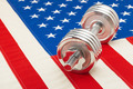 Metal dumbbell over US flag as symbol of healthy life style - studio shot - PhotoDune Item for Sale