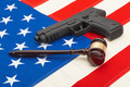 Wooden judge gavel and gun over USA flag - studio shoot - PhotoDune Item for Sale