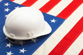 White color construction helmet laying over US flag - closeup shoot - PhotoDune Item for Sale