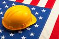 Construction helmet laying over USA flag - closeup shoot - PhotoDune Item for Sale