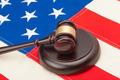 Wooden judge gavel and soundboard laying over USA flag - closeup studio shoot - PhotoDune Item for Sale