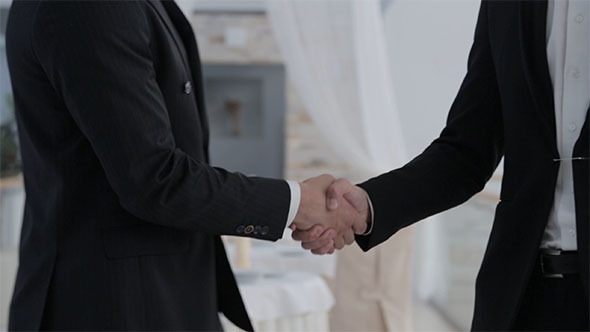 Handshake of City Businessmen
