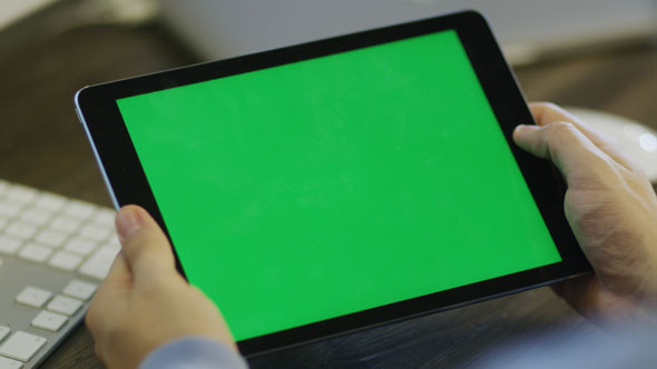 Designer using Digital Tablet with Green Screen 2