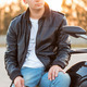 Biker man wearing a leather jacket sitting on his motorcycle out - PhotoDune Item for Sale