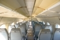 Interior of an airplane with many seats - PhotoDune Item for Sale