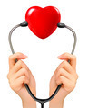 Medical background with hands holding a stethoscope with red heart. - PhotoDune Item for Sale