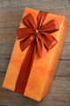 beautifully decorated gift box with bow on wooden - PhotoDune Item for Sale