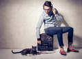 handsome man and cat listening to music on a magnetophone against grunge wall - PhotoDune Item for Sale