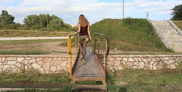 Girl Crossing the Small Bridge 1