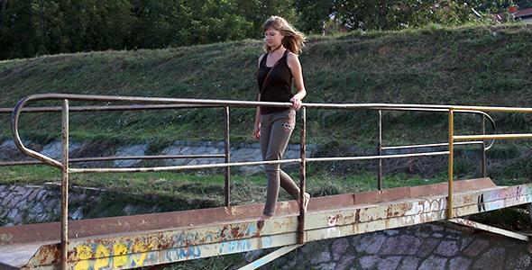Girl Crossing the Small Bridge 5
