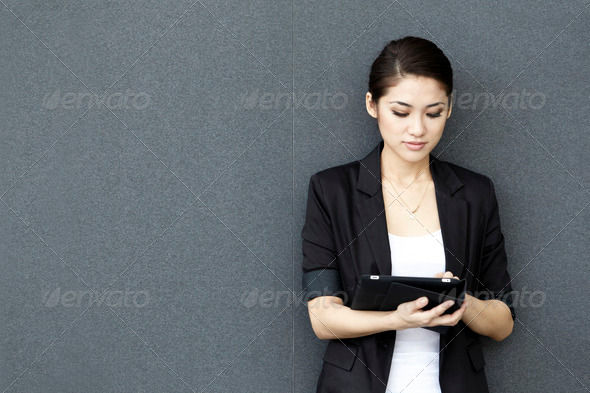 PhotoDune Asian Business woman using a tablet 911872